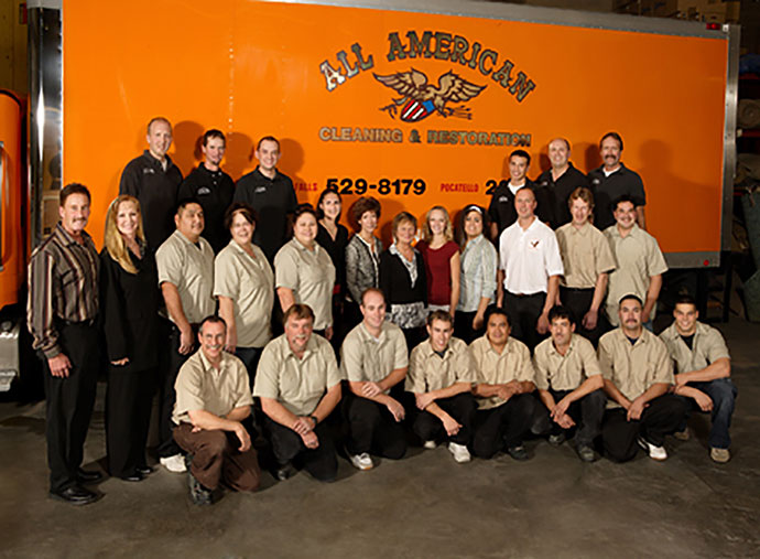 a group photo of All American Cleaning's staff