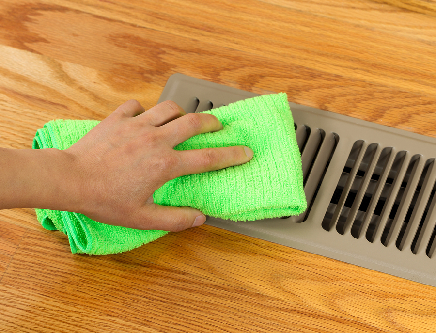 person cleaning vent
