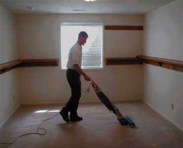 a tech vacuuming a room